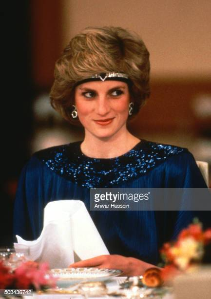 Diana Princess of Wales wears a pleated royal blue evening dress designed by fashion designer Yuki and a sapphire and diamond headband made from...