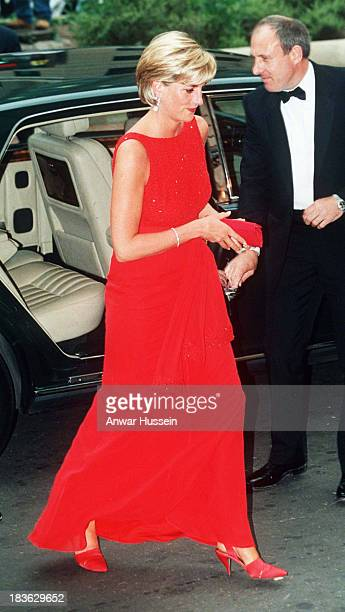 Diana Princess of Wales wears a red Jacques Azagury dress as she attends a fund raising dinner for the American Red Cross on June 17 1997 in...
