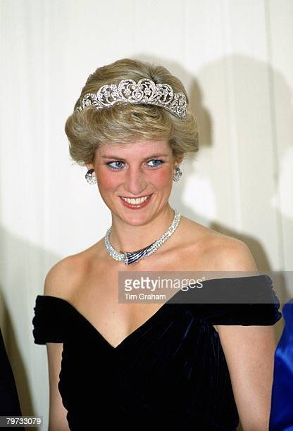 Diana, Princess of Wales wears a sapphire and diamond necklace, which was a gift from the Sultan of Oman, and the Spencer Tiara with a dress designed...