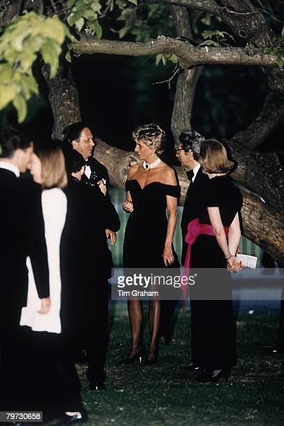 Diana Princess of Wales wears a short black cocktail dress designed by Christina Stambolian to a Gala at the Serpentine Gallery in Hyde Park