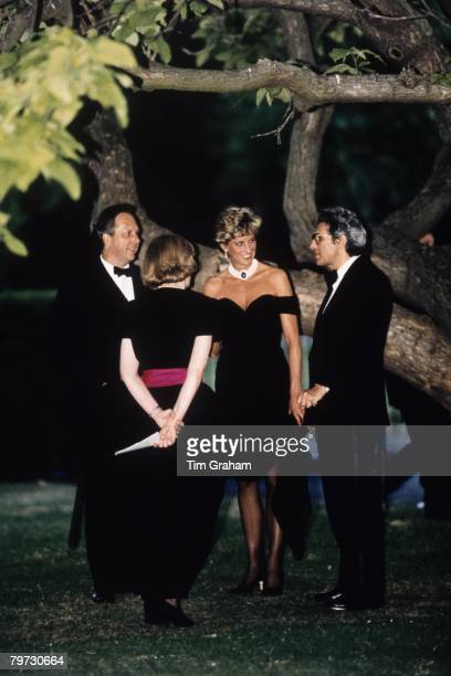 Diana, Princess of Wales wears a short black cocktail dress designed by Christina Stambolian to a Gala at the Serpentine Gallery in Hyde Park