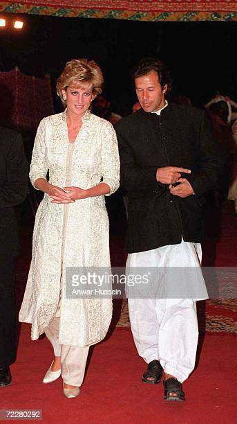 Diana Princess of Wales wears a traditional Shalwar Kameez as she walks with Imran Khan in April 1996 in Lahore Pakistan