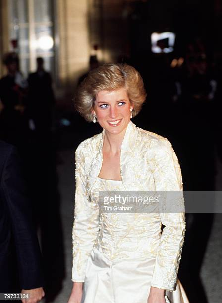 Diana, Princess of Wales wears a white beaded dress and bolero designed by Victor Edelstein to a banquet at the Elysee Palace in Paris