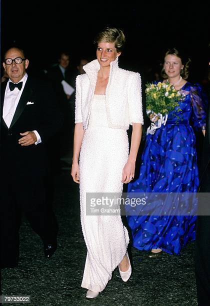 Diana, Princess of Wales wears a white Catherine Walker gown, known as the Elvis dress, with matching bolero jacket to the British Fashion Awards at...