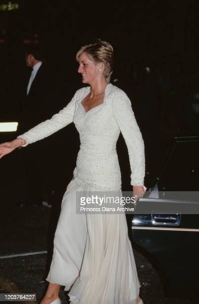 Diana, Princess of Wales wears a white evening gown by Catherine Walker to the Black and White Ball in London, September 1990.