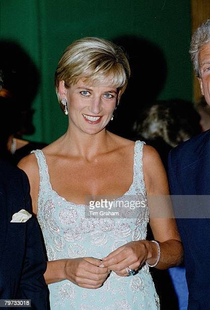 Diana Princess of Wales wears an embroidered cocktail dress designed by fashion designer Catherine Walker at the private viewing and reception at...