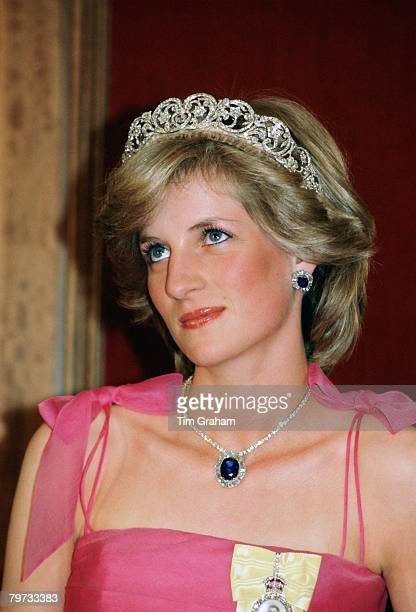 Diana Princess of Wales wears the Spencer family tiara with a suite of sapphire and diamond jewels which had been a gift from the Crown Prince of...