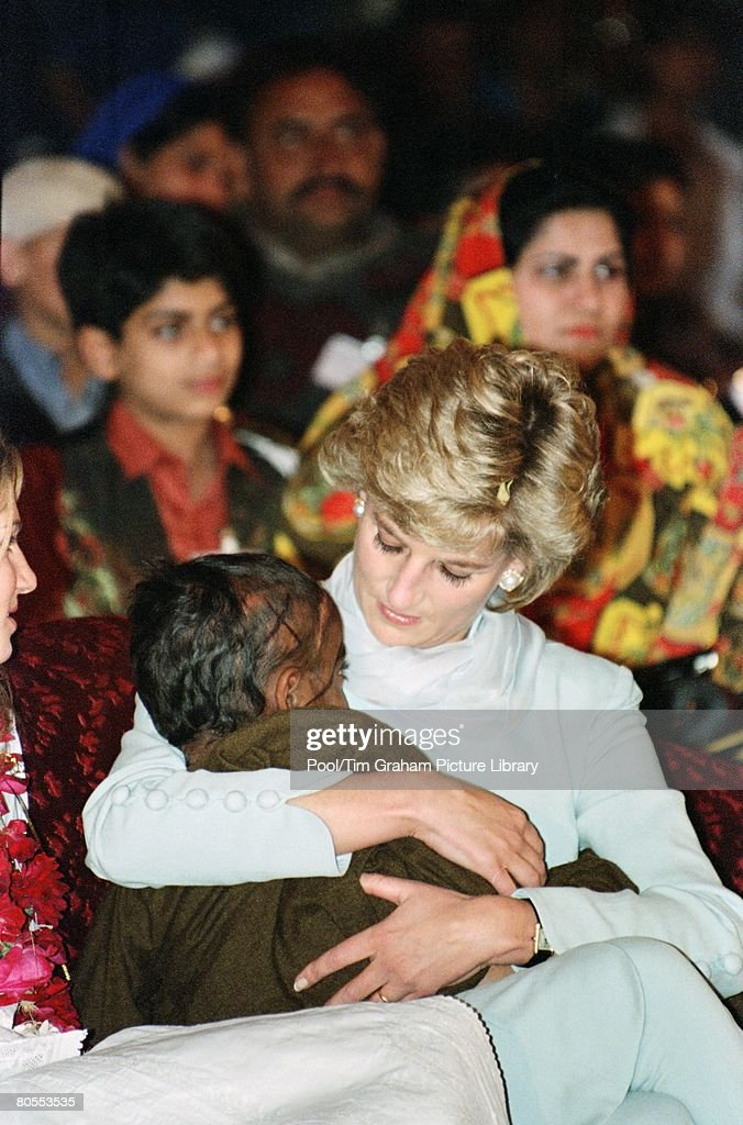 Diana, Princess of Wales with a young pakistani child on her : News Photo