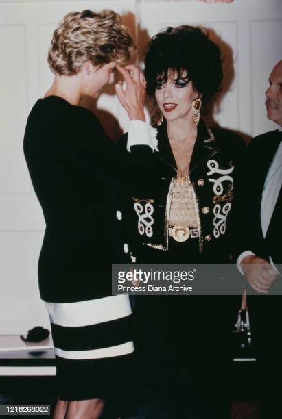 Diana, Princess of Wales with actress Joan Collins during a tribute concert to Sammy Davis Jr at the Royal Albert Hall in London, 23rd June 1992.