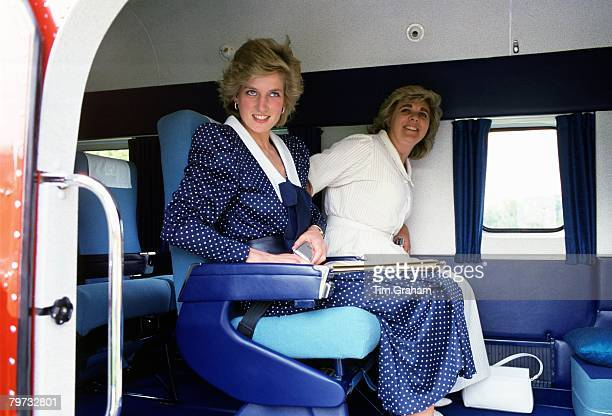 Diana, Princess of Wales with Anne Beckwith-Smith, her Lady-in-Waiting and Private Secretary, board a helicopter outside Kensington Palace