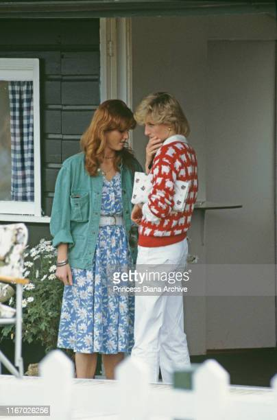 Diana Princess of Wales with her friend Sarah Ferguson at a polo match at Smith's Lawn Guards Polo Club Windsor June 1983 Diana is wearing a Muir and...