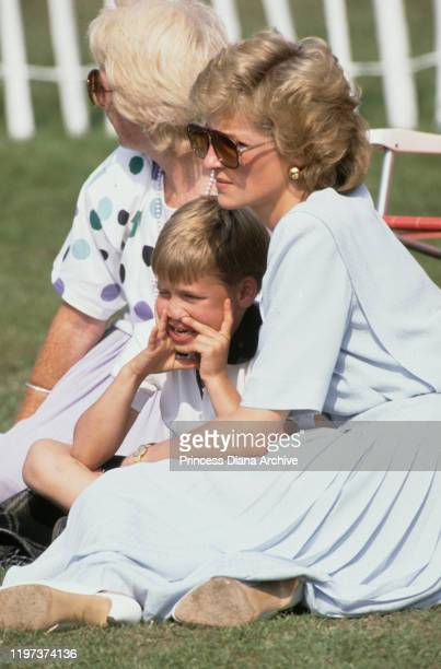 Diana Princess of Wales with her mother Frances Shand Kydd and her son Prince William at a Cartier International Polo match on Smith's Lawn in...