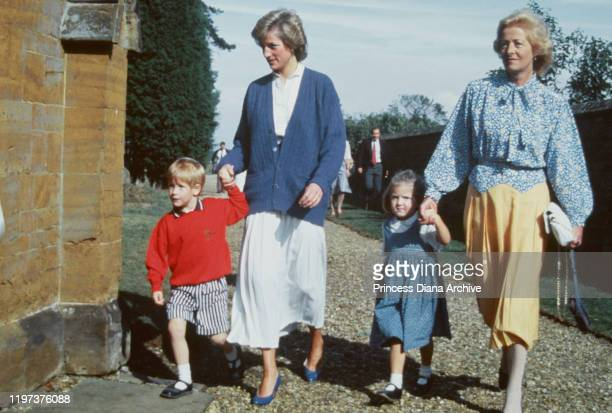 Diana Princess of Wales with her son Prince Harry and her mother Frances Shand Kydd at St Mary's Church in Great Brington Northamptonshire for a...