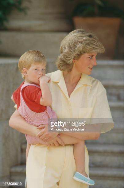 Diana, Princess of Wales with her son Prince Harry during a holiday with the Spanish royal family at the Marivent Palace in Palma de Mallorca, Spain,...