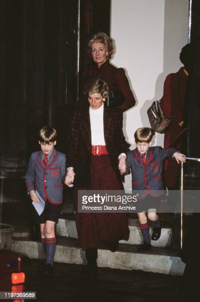 Diana Princess of Wales with her sons Prince William and Prince Harry at St Matthew's Church in London after the Wetherby School Christmas carol...