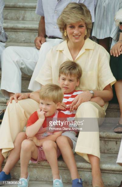 Diana, Princess of Wales with her sons William and Harry during a holiday with the Spanish royal family at the Marivent Palace in Palma de Mallorca,...