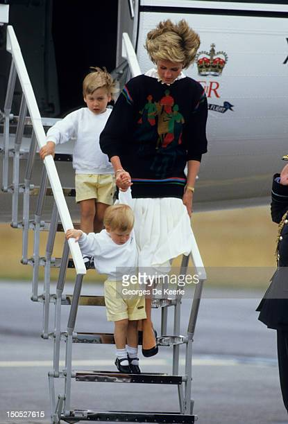 Diana Princess of Wales with her young sons Prince William and Prince Harry arrive at Aberdeen Airport for the start of their holidays in Scotland on...