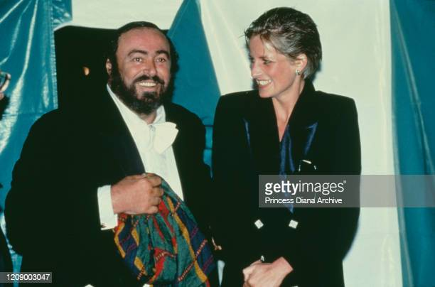 Diana, Princess of Wales with Italian opera singer Luciano Pavarotti during a free concert in Hyde Park, London, 31st July 1991. Diana's hair is wet...