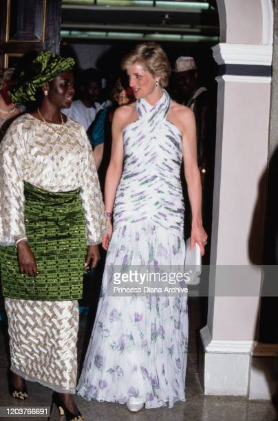 Diana Princess of Wales with Maryam Babangida the wife of the Nigerian President during a presidential banquet in Lagos Nigeria March 1990 Diana is...