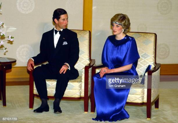 Diana Princess Of Wales With Prince Charles Before Dinner With Emperor Hirohito In Japan She Is Wearing A Pleated Royal Blue Evening Dress Designed...