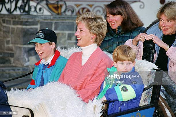 Diana Princess of Wales with Prince William and Prince Harry in a sleigh during a skiing holiday in Lech Austria Sitting behind them are Diana's...