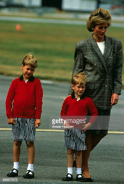 Diana Princess of Wales with Prince William and Prince Harry wearing identical red jumpers and stripey shorts arrive at Aberdeen Airport at the start...