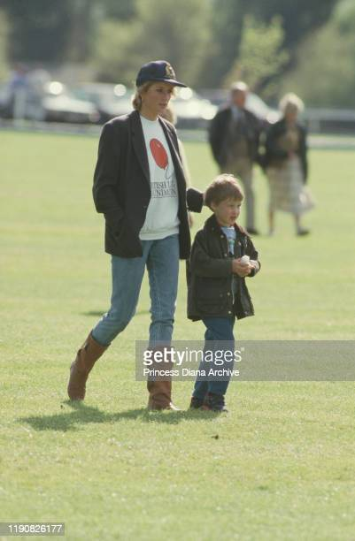 Diana, Princess of Wales with Prince William at the Guards Polo Club in Windsor, 2nd May 1988. She is wearing a British Lung Foundation sweatshirt.