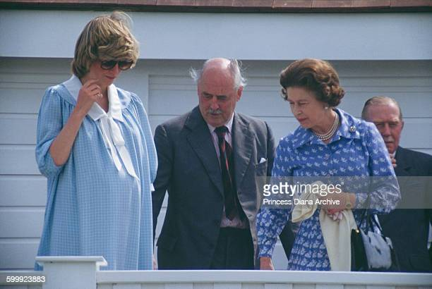 Diana Princess of Wales with Queen Elizabeth II during a polo match at the Guards Polo Club Windsor UK 30th May 1982 Diana is heavily pregnant with...