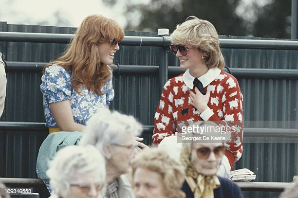 Diana, Princess of Wales with Sarah Ferguson at the Guard's Polo Club, Windsor, June 1983. The Princess is wearing a jumper with a sheep motif from...
