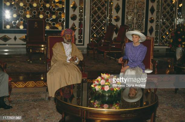 Diana, Princess of Wales with Sultan Qaboos bin Said al Said of Oman in the Al Alam Palace, Muscat, Oman, 11th November 1986. Diana is wearing a suit...
