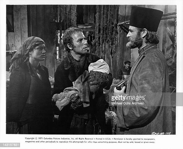 Diana Quick and John Shrapnel looking to Julian Glover in a scene from the film 'Nicholas And Alexandra' 1971
