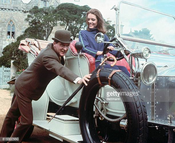 Diana Rigg as Mrs Emma Peel on the British spy series The Avengers She is shown at the wheel of a car which is being pushed by costar Patrick MacNee...