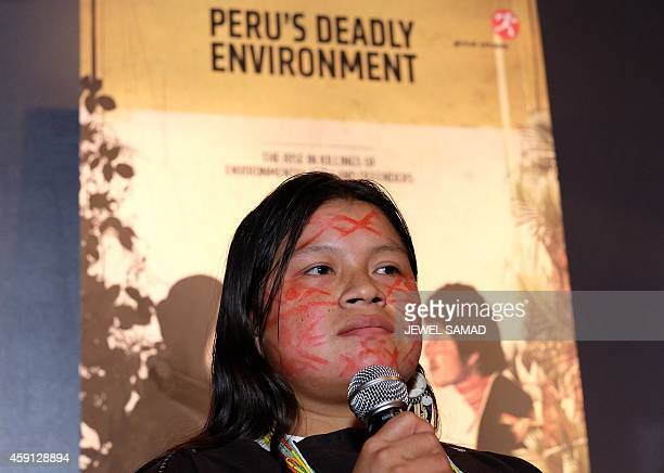 Diana Rios Rengifo, the daughter of one of the four indigenous Ashéninka leaders murdered in the Peruvian Amazon in early September, speaks during a...