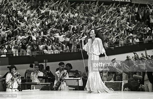 Diana Ross performs on stage with band and cheering audience behind at Ahoy on 13th June 1982 in Rotterdam Netherlands