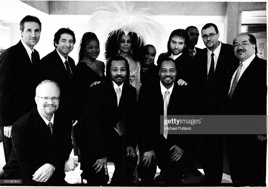 Diana Ross poses backstage with her band, London, 2004.
