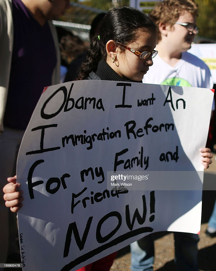 Diana Saravia, 10, participates in a rally with on immigration reform in front of the White House on November 8, 2012 in Washington, DC. Immigrant rights organizations called on President Barack Obama to fulfill his promise of passing comprehensive immigration reform.