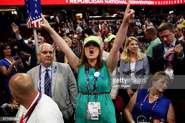 Diana Shores from Farmville VA protests a roll call vote on the floor on the first day of the Republican National Convention on July 18 2016 at the...