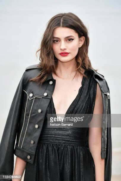 Diana Silvers attends the Saint Laurent Mens Spring Summer 20 Show on June 06 2019 in Paradise Cove Malibu California