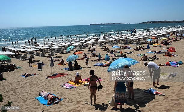 Diana Simeonova People enjoy the sun at the beach of the Black Sea resort of Sunny Beach near the city of Bourgas on July 22 2012 Sunbathing gambling...