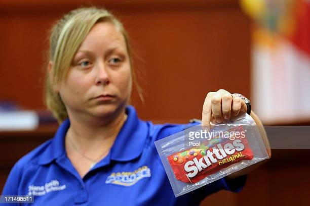 Diana Smith crime scene technician for the Sanford Police Department shows the jury a bag of Skittles that was collected as evidence at the crime...
