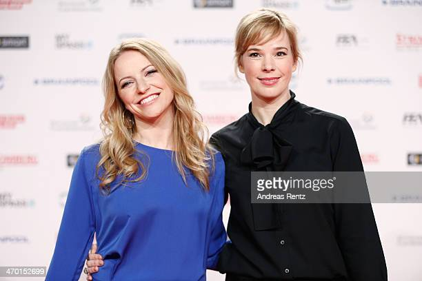 Diana Staehly and Milena Dreissig attend the World premiere of Stromberg Der Film at Cinedom Koeln on February 18 2014 in Cologne Germany