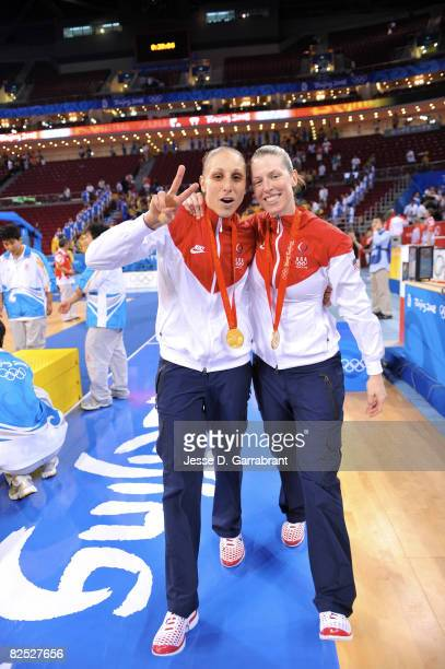 Diana Taurasi and Katie Smith of the U.S. Women's Senior National Team celebrate after winning the gold medal against Australia at the Beijing...