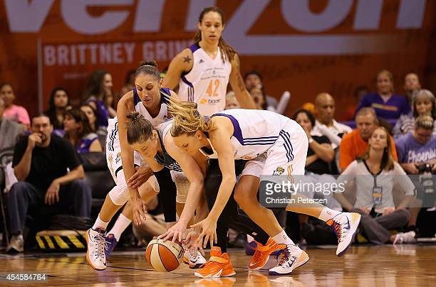 Diana Taurasi and Penny Taylor of the Phoenix Mercury battle for a loose ball with Lindsay Whalen of the Minnesota Lynx during game three of the WNBA...