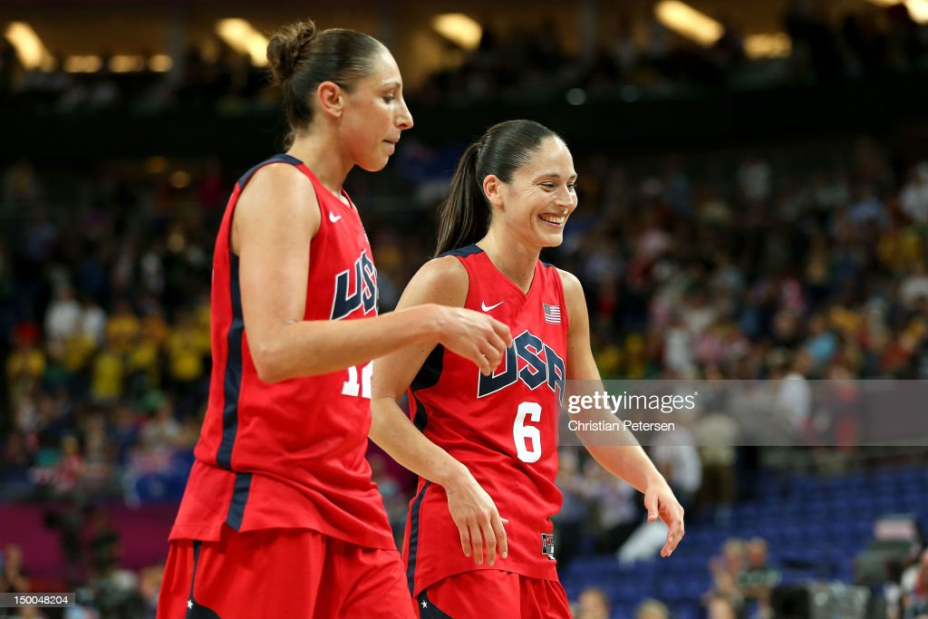Diana Taurasi #12 and Sue Bird #6 of United States celebrate as they walk off the court following their 86-73 victory over Australia in the Women's Basketball semifinal on Day 13 of the London 2012 Olympics Games at North Greenwich Arena on August 9, 2012 in London, England.