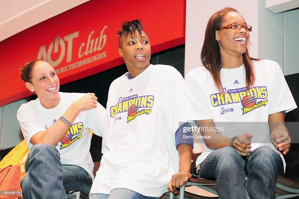 Diana Taurasi #3, Cappie Pondexter #23, and Tangela Smith #50 of the Phoenix Mercury react during the WNBA Championship Rally at US Airways Center on October 12, 2009 in Phoenix, Arizona.