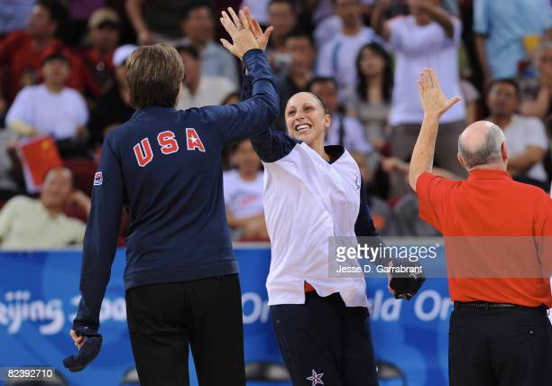 Diana Taurasi high-fives head coach Anne Donovan of the U.S. Women's Senior National Team during the game against New Zealand during the women's...