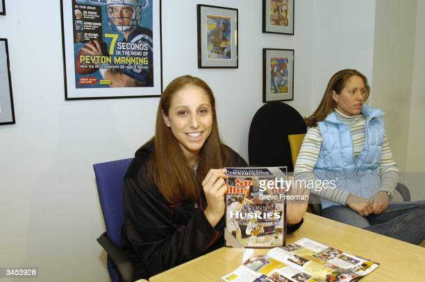 Diana Taurasi holds up a copy of Sports Illustrated during her day in New York City on April 15 2004 before the WNBA Draft NOTE TO USER User...
