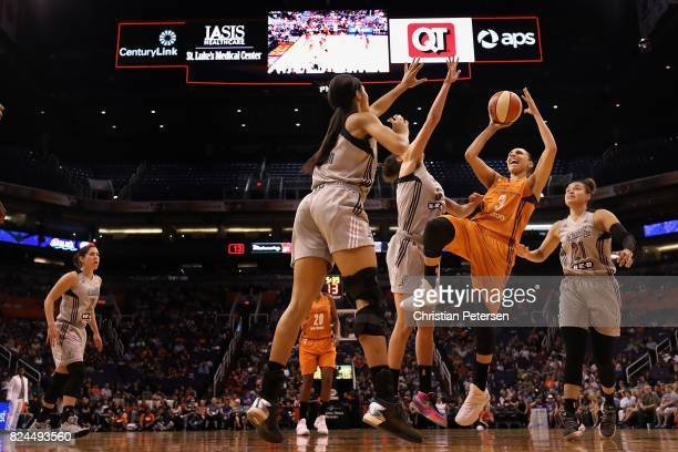 Diana Taurasi of the Phoenix Mercury attempts a shot over Isabelle Harrison of the San Antonio Stars during the first half of the WNBA game at...