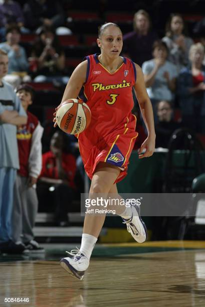 Diana Taurasi of the Phoenix Mercury dribbles the ball during a preseaon game May 16 2004 at Key Arena in Seattle Washington NOTE TO USER User...