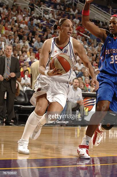 Diana Taurasi of the Phoenix Mercury drives against Cheryl Ford of the Detroit Shock during Game Four of the WNBA Finals at US Airways Center on...